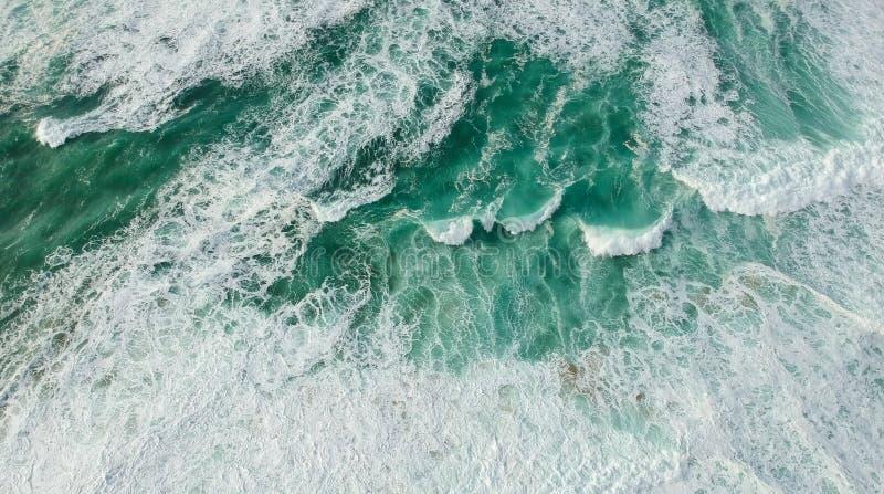 Aerial view ocean with waves. Portuguese coastline `Praia Grande` beach in Sintra. Drone photo stock image
