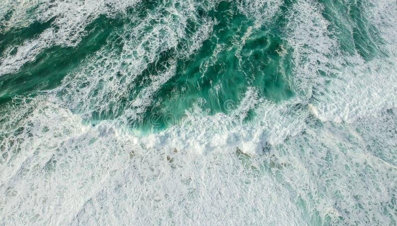 Aerial view ocean with waves. Portuguese coastline `Praia Grande` beach in Sintra. Drone photo royalty free stock photo