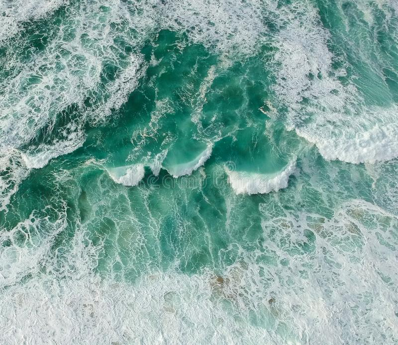 Aerial view ocean with waves. Portuguese coastline `Praia Grande` beach in Sintra. Drone photo royalty free stock photography