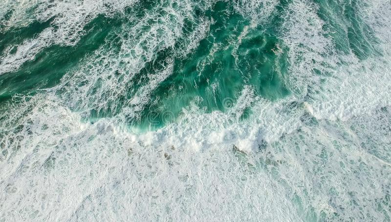 Aerial view ocean with waves. Portuguese coastline `Praia Grande` beach in Sintra. Drone photo royalty free stock photos