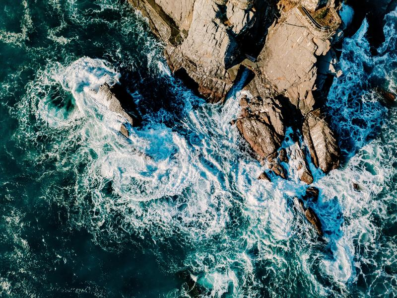Aerial view of ocean waves and rocks. Blue sea surface. Aerial view of ocean waves and rocks. Blue and turquoise sea surface royalty free stock images