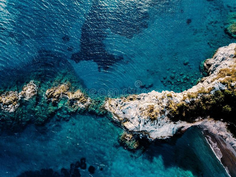 Aerial view of ocean waves and rocks. Blue sea surface. Aerial view of ocean waves and rocks. Blue and turquoise sea surface stock photos