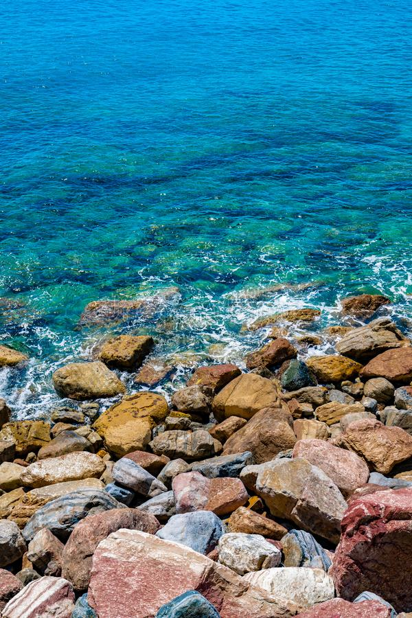 An Aerial view of ocean waves and Rocky coast. / italy royalty free stock image