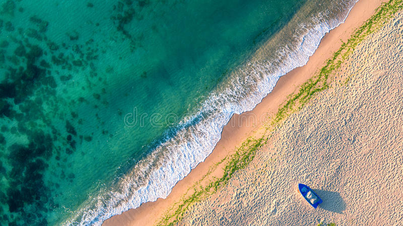 Aerial view of ocean waves and sand on beach royalty free stock photos