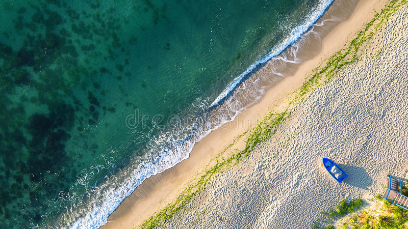 Aerial view of ocean waves and sand on beach.  stock photo