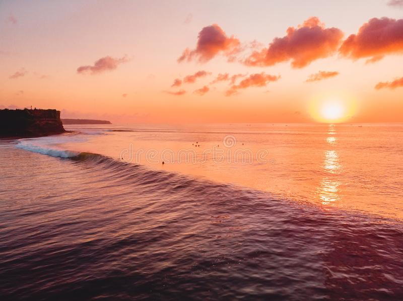 Aerial view of ocean with waves, surfers and sunset. Aerial view of ocean with waves, surfers and warm sunset stock photography