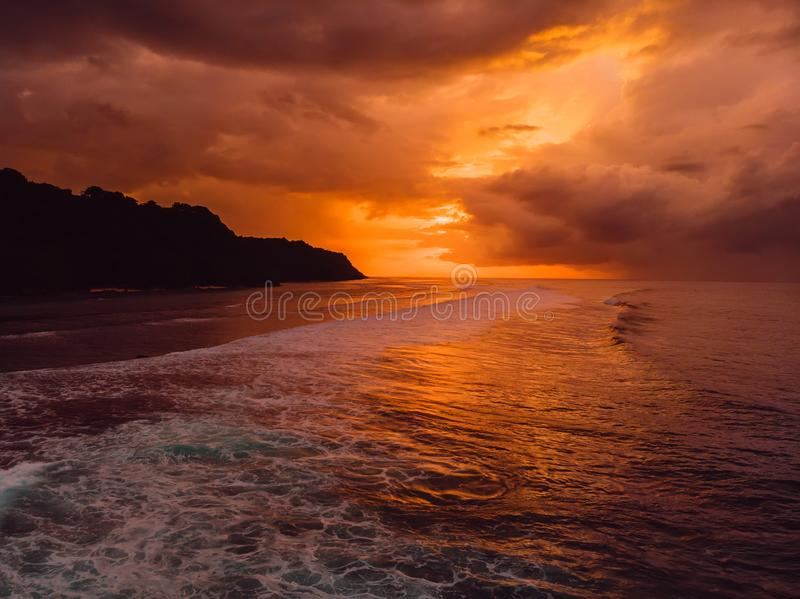 Aerial view of ocean with waves and warm sunset. Or sunrise stock photo