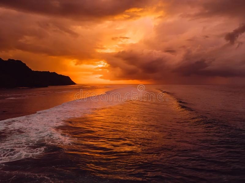 Aerial view of ocean with waves and warm sunset or sunrise. Aerial view of ocean with waves and warm sunset royalty free stock photos