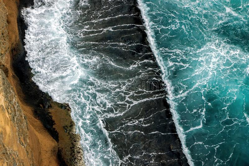 Aerial view of ocean waves on cliff. Aerial view of ocean waves wash up on cliff royalty free stock photo