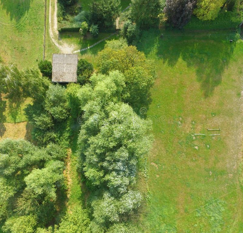 Free Aerial View Of A Meadow Bordering A Lawn, With A Shed And Several Bushes And Trees Stock Photo - 117382820