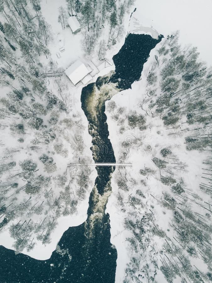 Free Aerial View Of Icy River Flowing Through A Beautiful Snowy Winter Scenery In Oulanka National Park. Finland. Stock Image - 108706491