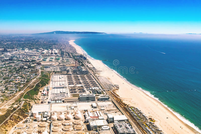 Aerial view of an oil refinery on the beach of LA stock images