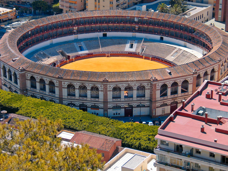 Aerial view of old bullring. In Andalusia, Malaga, Spain constrained by contemparary buildings royalty free stock photography
