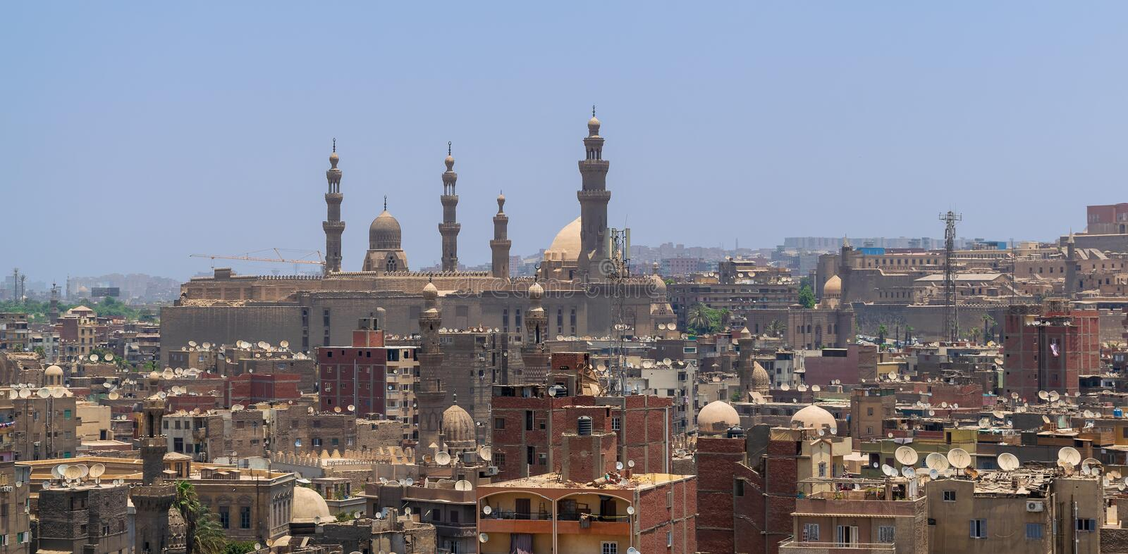 Aerial view of old Cairo, Egypt with grunge buildings and Sultan Hasan Mosque in far distance stock images