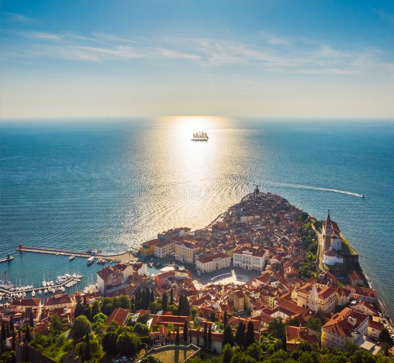 Aerial view of the old city Piran and beautiful sailing ship with five masts at sunset time. Slovenia, Europe.  stock photography