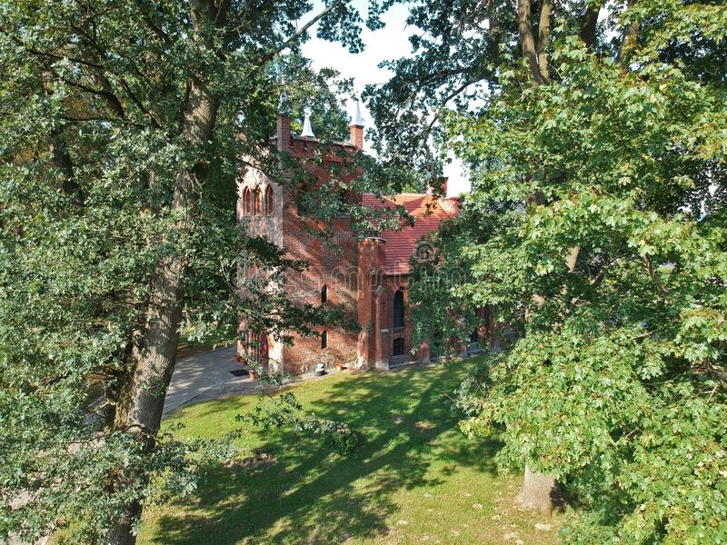 Aerial view on old gothic church hidden in forest. royalty free stock images