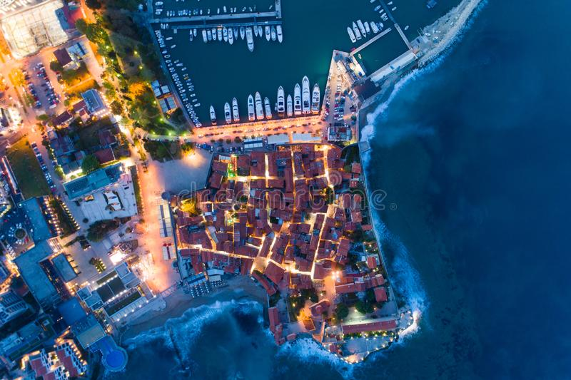 Aerial view of the Old Town Budva at night. With town illuminations royalty free stock photo