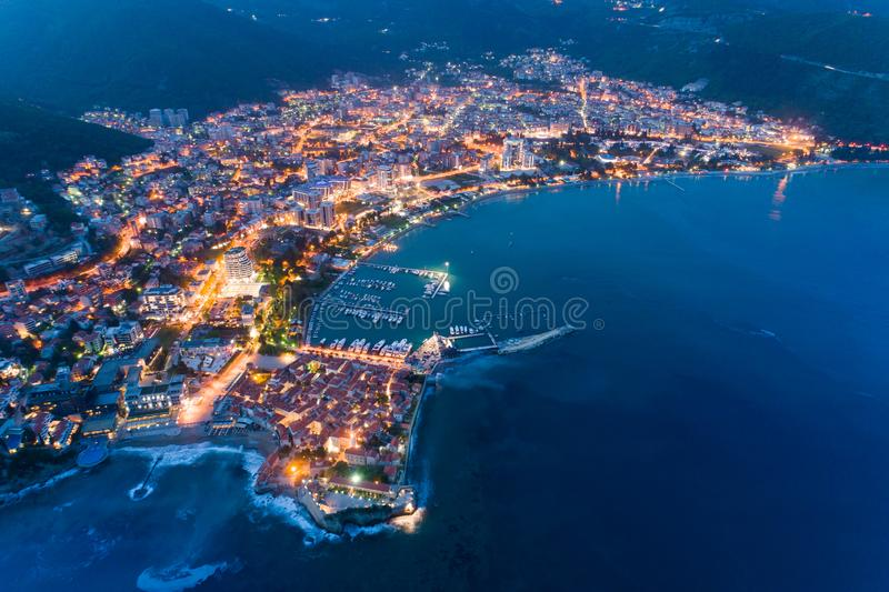 Aerial view of the Old Town Budva at night. With town illuminations stock photography