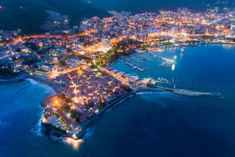Aerial view of the Old Town Budva at night. With town illuminations royalty free stock images