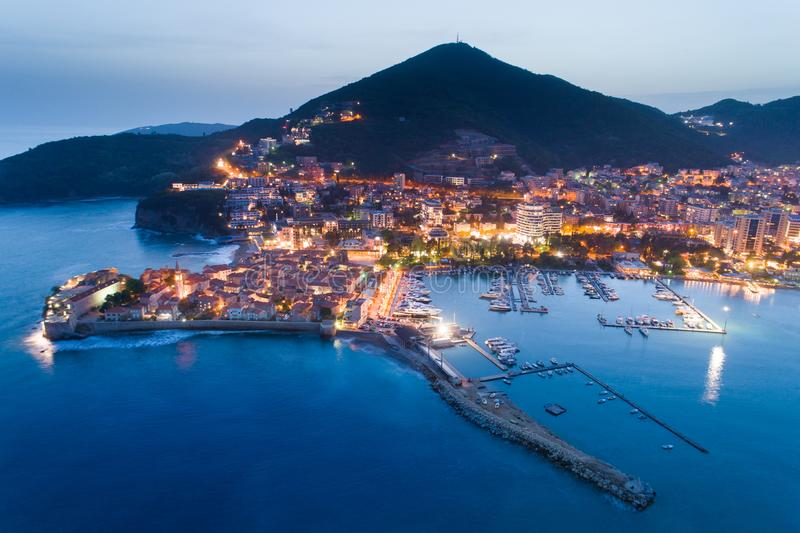 Aerial view of the Old Town Budva at night. With town illuminations stock images