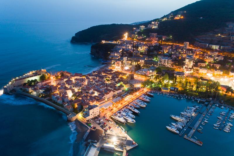Aerial view of the Old Town Budva at night. With town illuminations stock photo