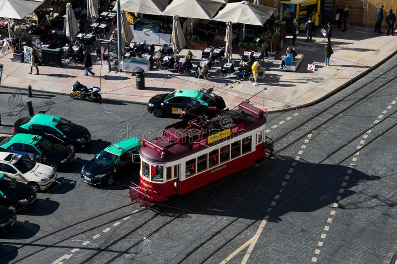 Aerial view of an old yellow tram on Lisbon streets royalty free stock photo