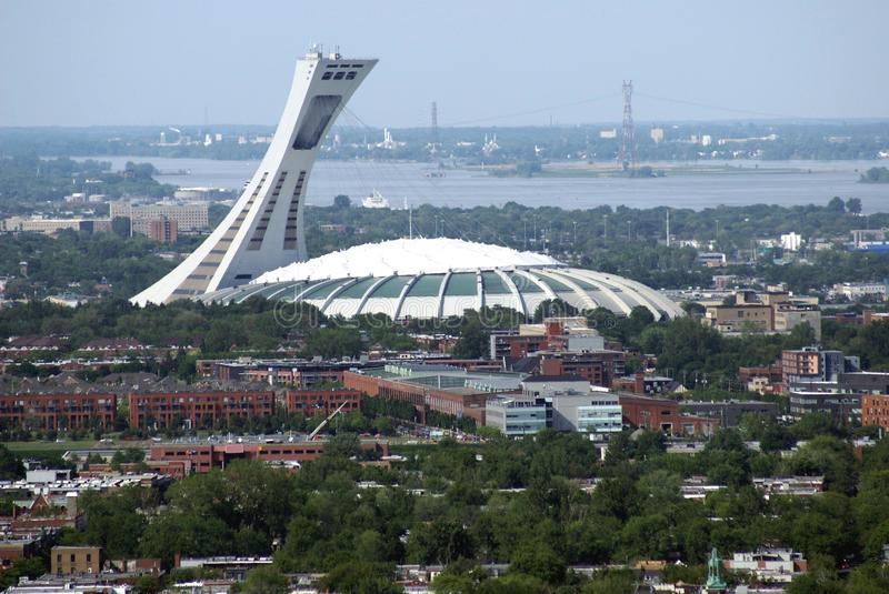 Aerial view of The Olympic Stadium & Montreal city in Quebec, Canada. Aerial view of Montreal city and The Olympic Stadium or The Big O or The Big Owe, which is stock images