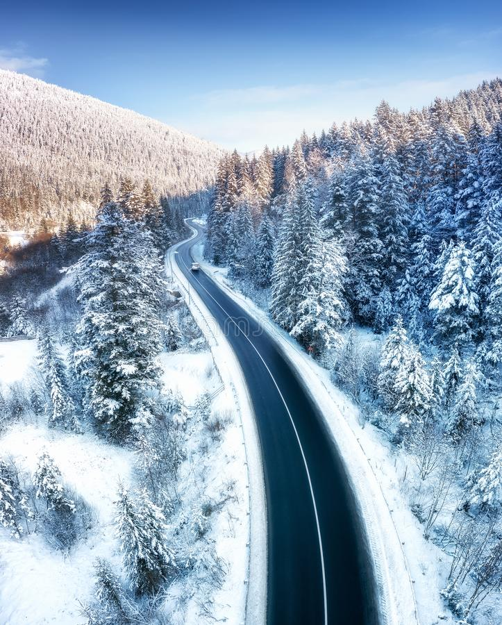 Free Aerial View On The Road And Forest At The Winter Time. Natural Winter Landscape From Air. Forest Under Snow A The Winter Time. Royalty Free Stock Images - 137177349