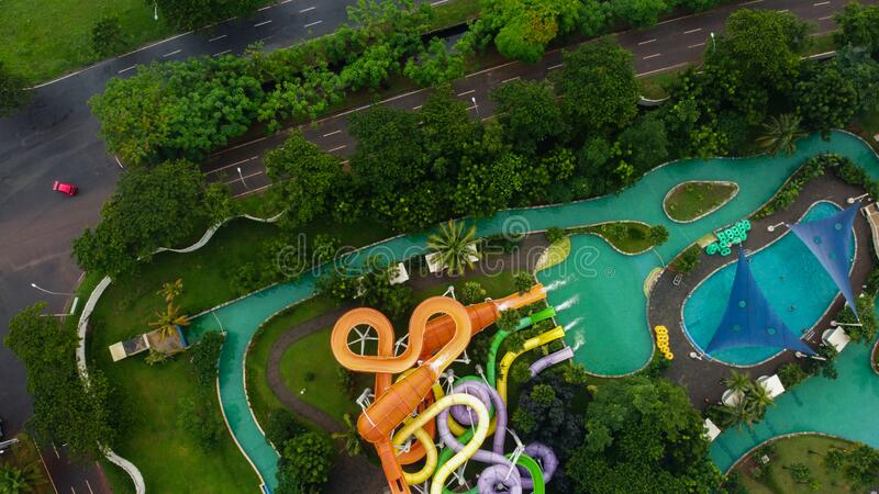 Aerial view of the open-air city swimming pool. Drone Shot view a blue pool at Bekasi - Indonesia stock photos