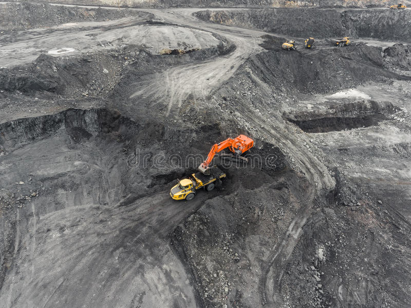 Aerial view open pit mine, loading of rock, mining coal, extractive industry. Anthracite royalty free stock photography