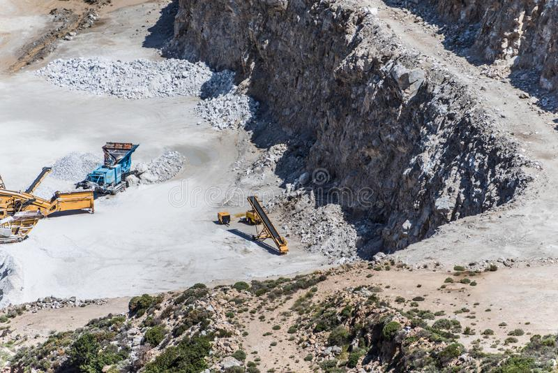 Aerial view of opencast mining quarry with lots of machinery at work - view from above. Aerial view of opencast mining quarry with lots of machinery at work royalty free stock photo