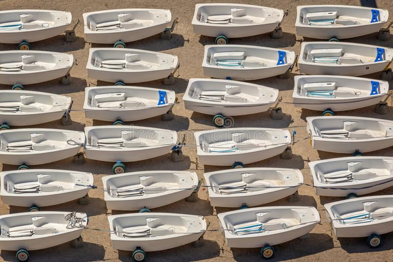 Aerial view of Optimist dinghies aligned. Sailing school boats. Background stock photo