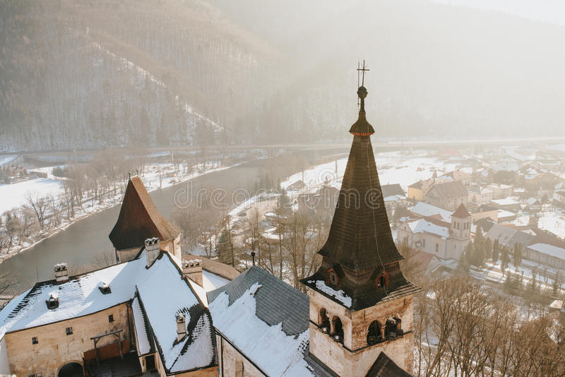 Aerial view of Oravsky Podzamok from Orava Castle in Slovakia. Old medieval tower. Beautiful winter landscape with sunshine stock photography