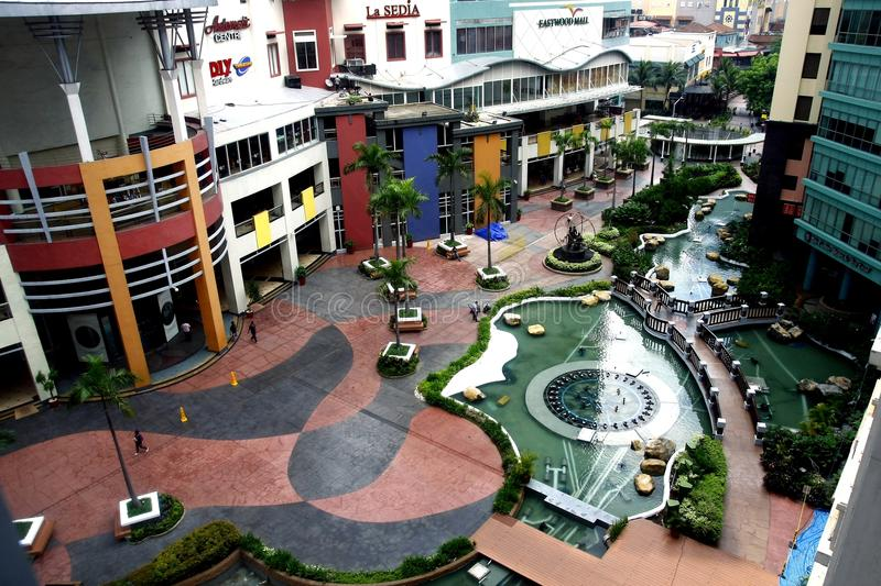 Aerial view of an outdoor park in the middle of the Eastwood Mall. QUEZON CITY, PHILIPPINES - JUNE 10, 2015: Aerial view of an outdoor park in the middle of the stock images