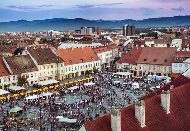 Aerial view over the Big Square. Sibiu City, Romania - 25 August 2019. Aerial view over the Big Square from Sibiu, Romania, during the Medieval Festival 2019 royalty free stock photos