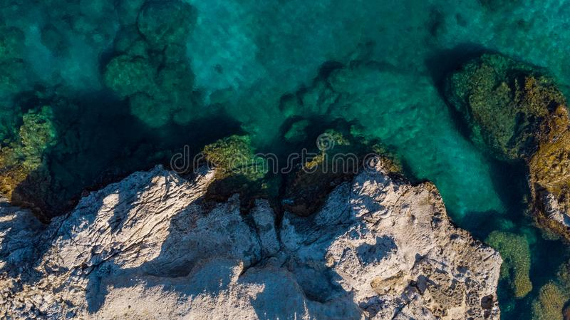 Aerial View Over Blue Waters and Rocky Beach in Greek Island royalty free stock image
