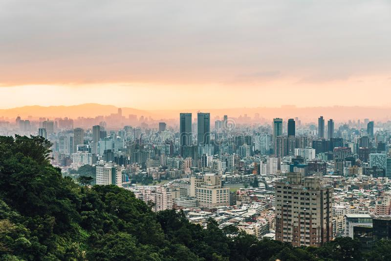 Aerial view over Downtown Taipei with layers of mountain in background in the dusk from Xiangshan Elephant Mountain in the evening stock photography