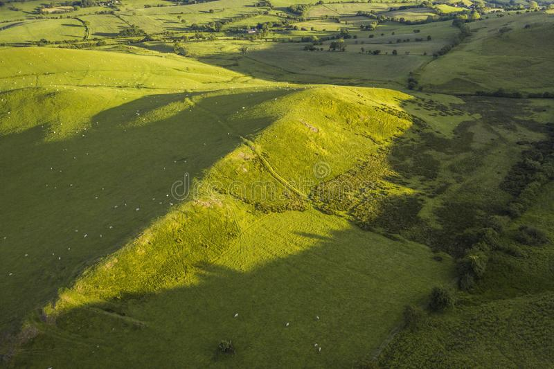 Aerial View over Green Countryside Hills in UK stock photography