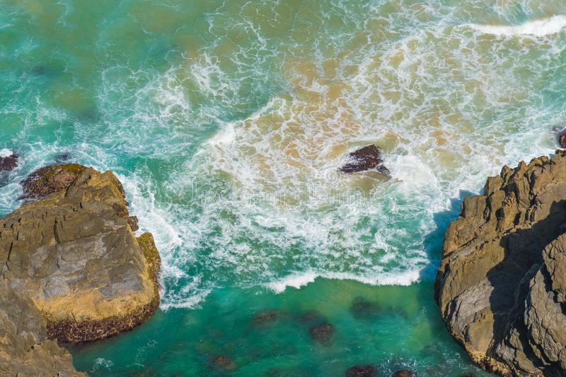 Aerial view over green turquoise water waves in Byron Bay, Australia. stock photography