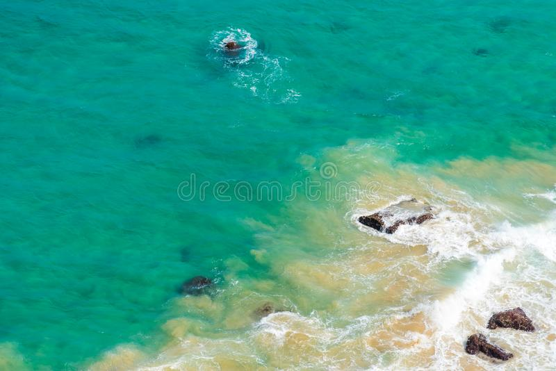 Aerial view over green turquoise water waves in Byron Bay, Australia royalty free stock photos