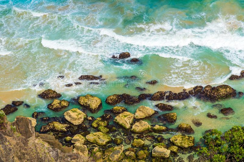 Aerial view over green turquoise water waves in Byron Bay, Australia stock images