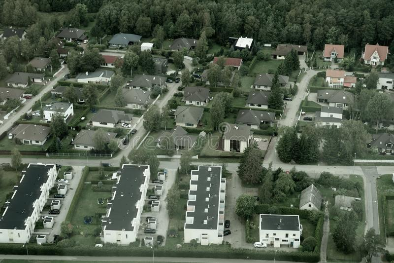 Aerial view over houses and forests in Tallinn Estonia royalty free stock photo