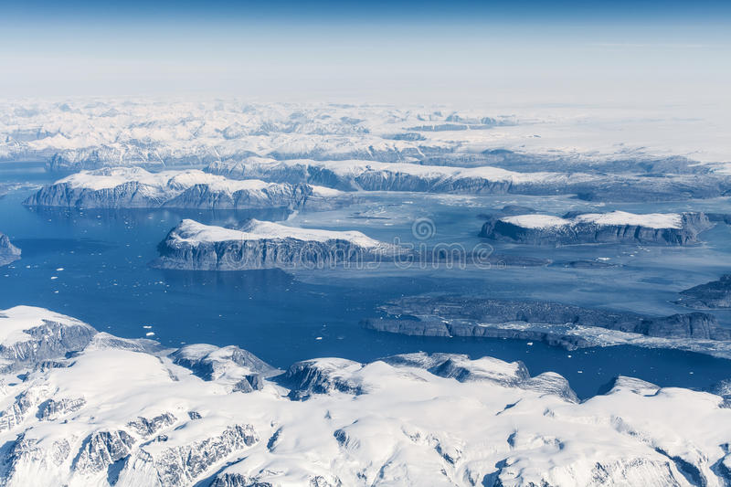 Aerial view over ice mountains in Greenland.  royalty free stock images