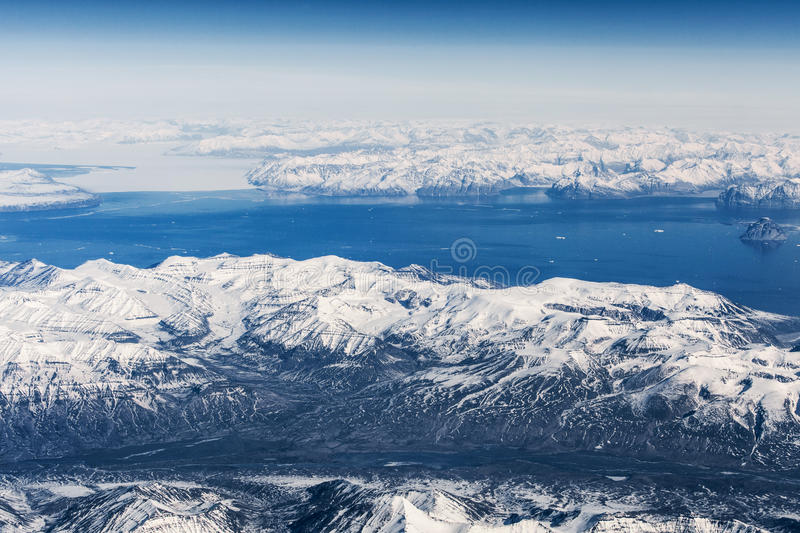 Aerial view over ice mountains in Greenland.  stock images