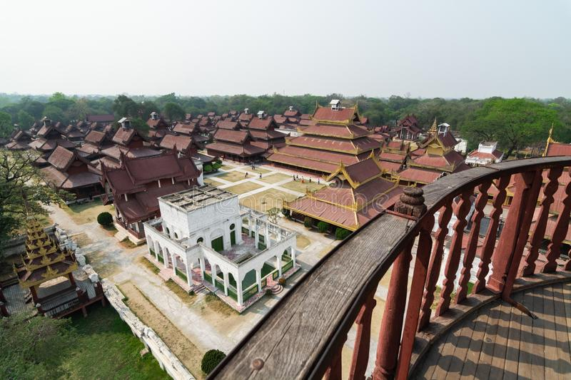 Aerial view over Mandalay Royal palace backyard, Myanmar. Wooden porch on the foreground, burma, burmese, residence, king, kingdom, luxury, ancient, history royalty free stock photo