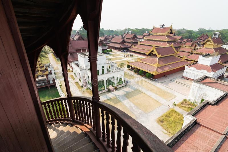 Aerial view over Mandalay Royal palace backyard, Myanmar. Wooden staircase on the foreground, burma, burmese, residence, king, kingdom, luxury, ancient stock photography
