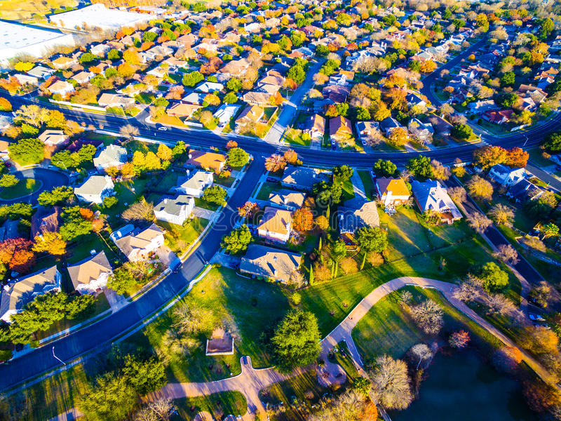 Aerial View Over Modern Suburb Home Community with Fall Colors. Aerial View Over Modern Suburb Home Community neighborhood with colorful Fall Autumn trees around royalty free stock photography
