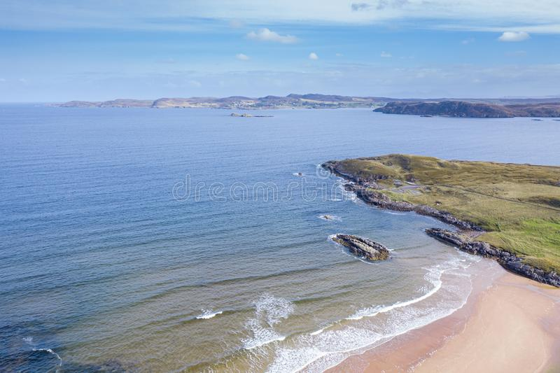 Aerial View over Northern Coast of Scotland. High altitude drone view over Firemore Beach looking towards Island of Ewe in the Northwest Highlands of Scotland royalty free stock photos