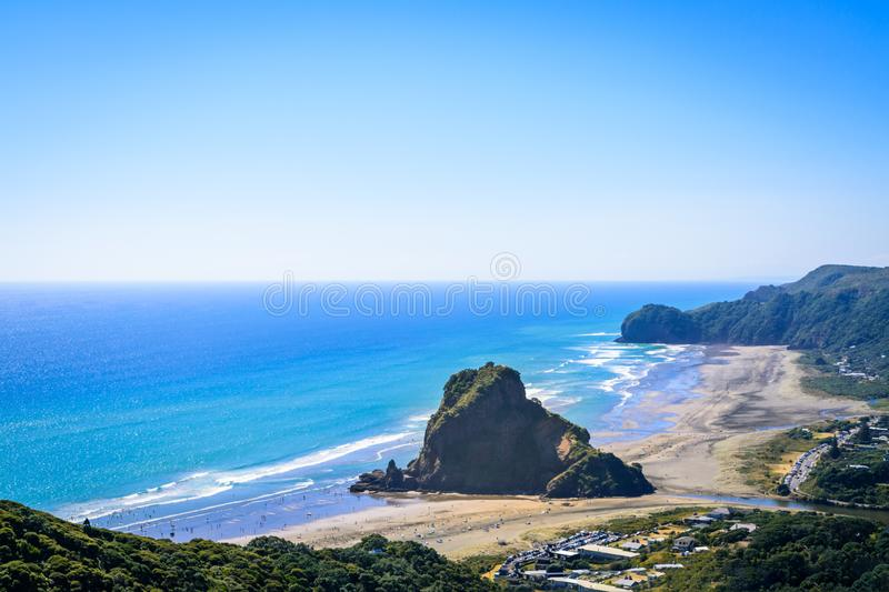 Aerial view over Piha beach, mighty Lion Rock in the centre, on the West coast of Auckland, New Zealand royalty free stock photography