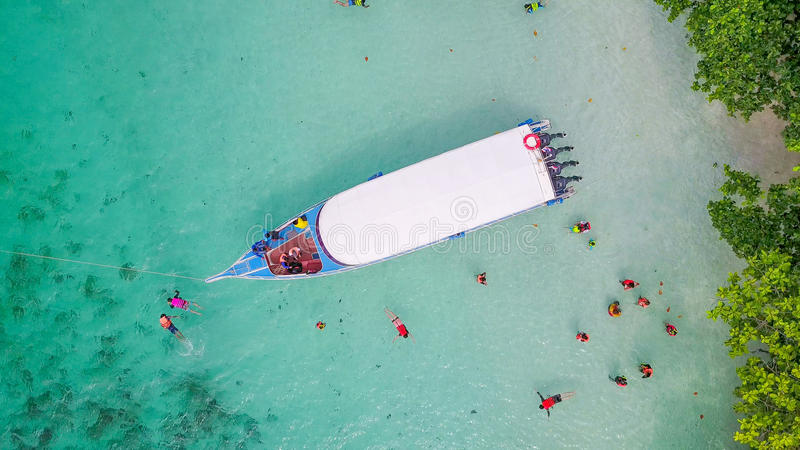 Aerial view over speed boat with beautiful sea and beach,Top vie stock photos